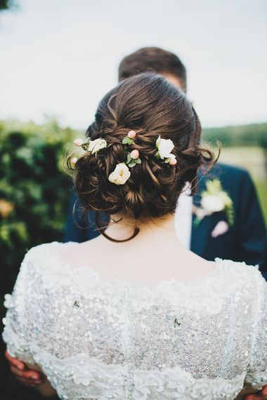 Loosely pinned wedding hair with flowers