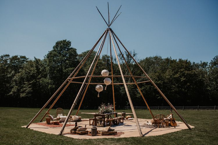 Outdoor naked tipi seating area at Wickerwood Farm