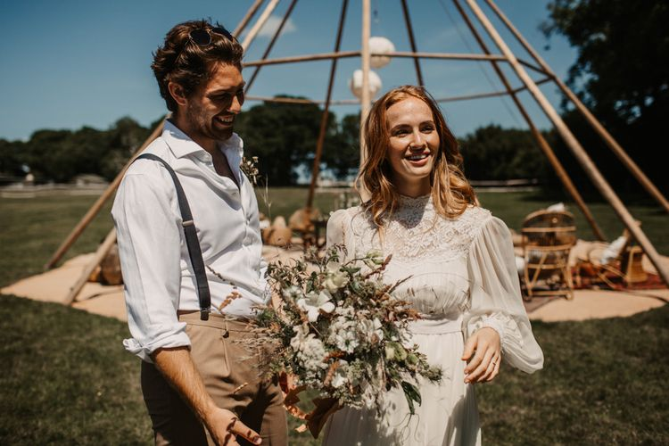 Boho bride and groom at eco-friendly wedding