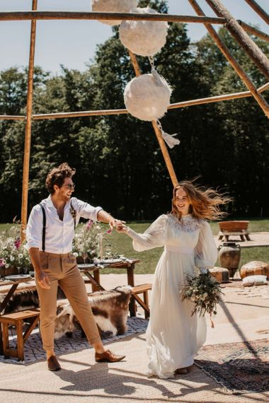 Bride and groom dancing at intimate outdoor reception