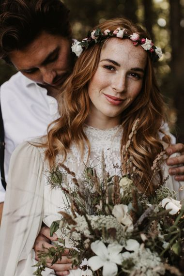 Beautiful boho bride with high neck wedding dress and flower crown