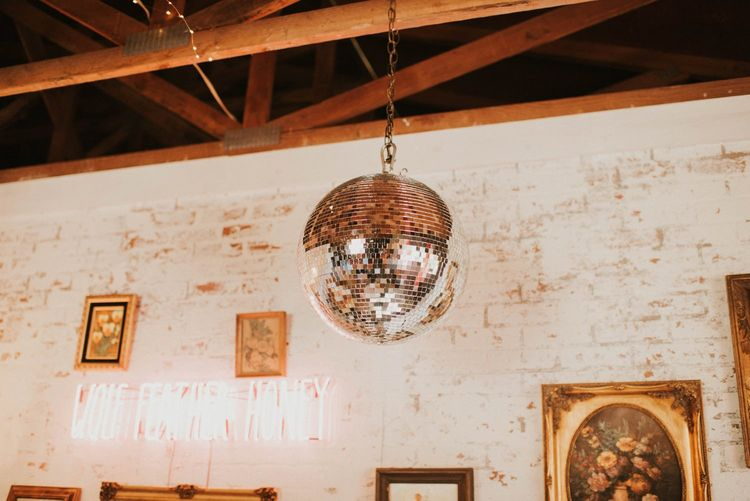 Disco ball for vegas elopement with sparkly wedding dress