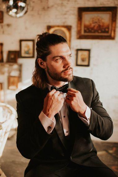 Groom in Tuxedo and box tie for Vegas elopement