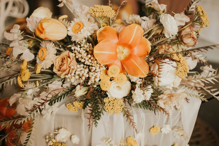 White, yellow and orange wedding bouquet for vegas elopement