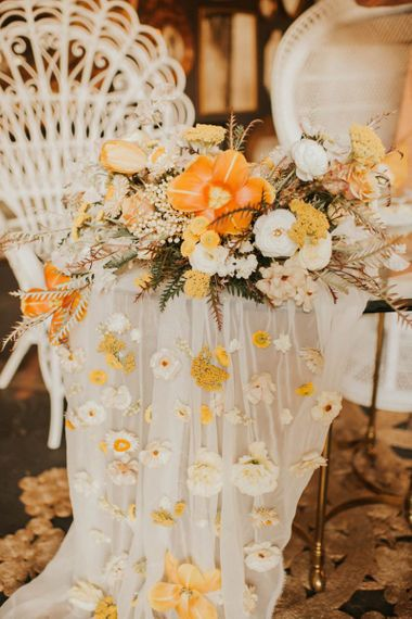 Sheer table cloth with flowers attached for vegas elopement