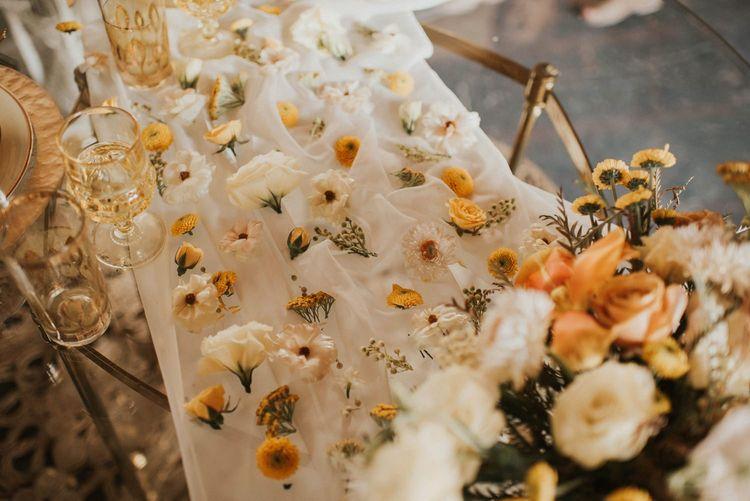 Flower table runner for Vegas Elopement with sparkly wedding dress