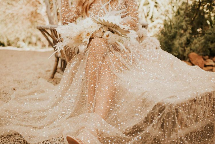 Boho bride in sparkly wedding dress