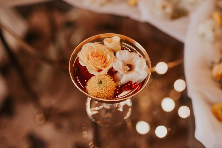 Champagne Saucer willed with flower heads