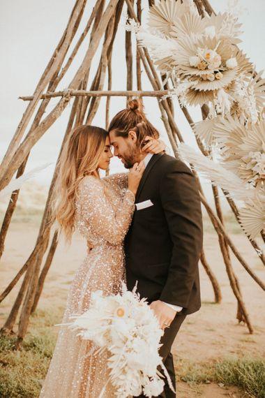 Intimate wedding portrait with bride in sparkly wedding dress