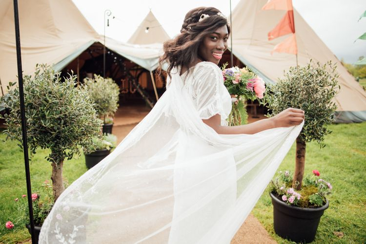 Bride With Cape Wedding Dress // World Inspired Tents Tipi Hire For Weddings South West England & Wales Tipi Hire Rock My Wedding The List Tipi Hire Supplier