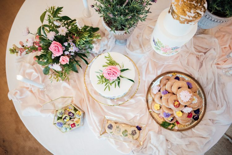 Dessert Table For Wedding With Edible Flowers // World Inspired Tents Tipi Hire For Weddings South West England & Wales Tipi Hire Rock My Wedding The List Tipi Hire Supplier