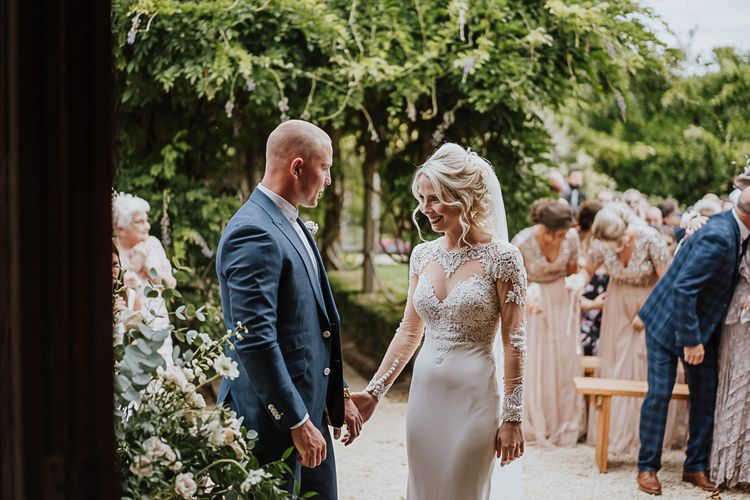 Wedding Ceremony | Bride in Lace Martina Liana Wedding Dress with Long Sleeves | Groom in Blue Moss Bros. Suit | Fairylight Tythe Barn Wedding with Dreamcatchers | New Forest Studio Photography