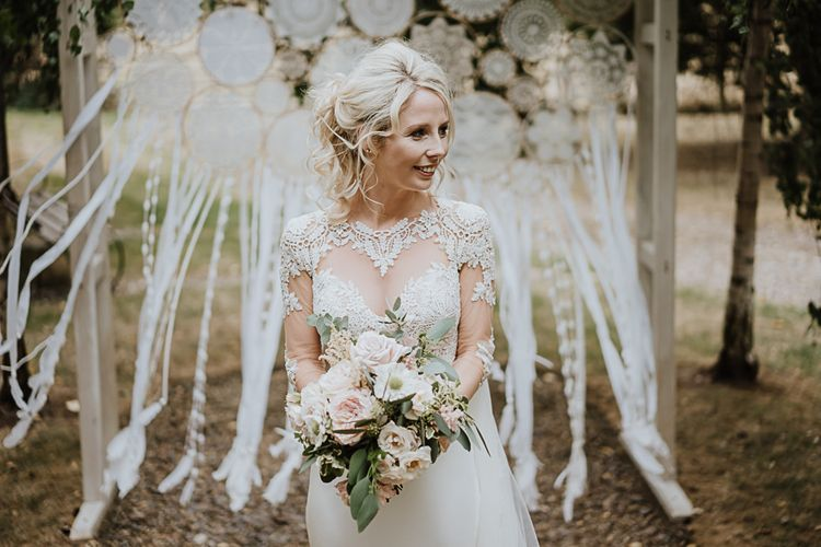Bride in Lace Martina Liana Wedding Dress with Long Sleeves | Pastel Flowers with Foliage | Fairylight Tythe Barn Wedding with Dreamcatchers | New Forest Studio Photography