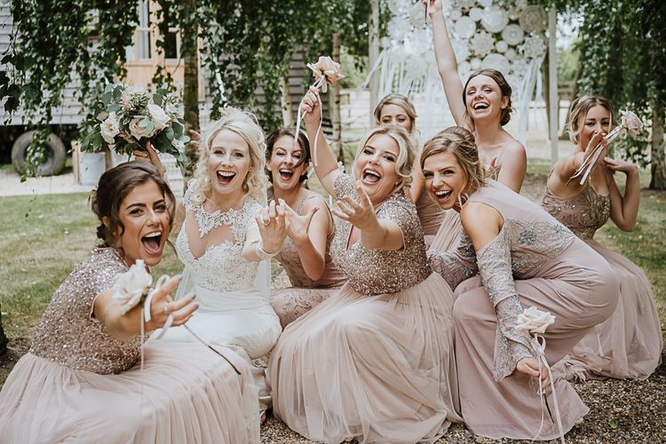 Bridal Party | Bridesmaids in Mismatched Blush Dresses  from ASOS | Bride in Lace Martina Liana Wedding Dress with Long Sleeves | Fairylight Tythe Barn Wedding with Dreamcatchers | New Forest Studio Photography