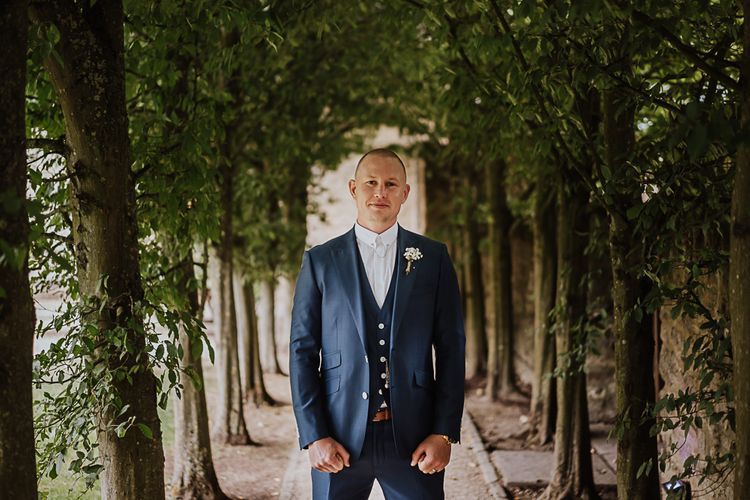 Groom in Blue Moss Bros. Suit | Fairylight Tythe Barn Wedding with Dreamcatchers | New Forest Studio Photography