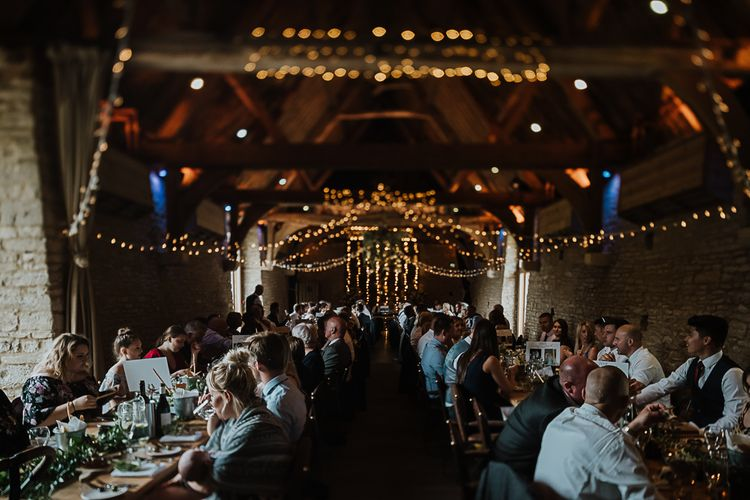 Wedding Reception Decor | Fairylights | Banquet Tables | Ivy | Fairylight Tythe Barn Wedding with Dreamcatchers | New Forest Studio Photography