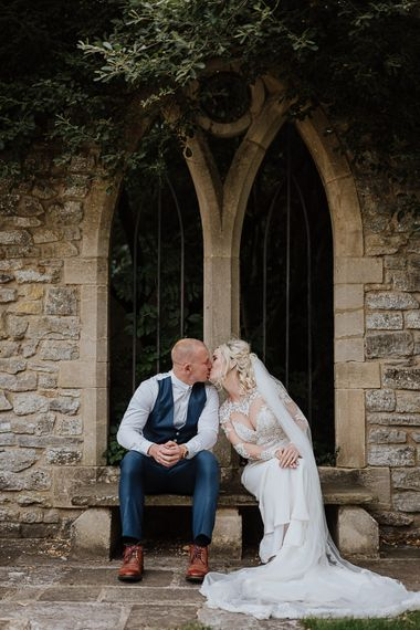 Bride in Lace Martina Liana Wedding Dress with Long Sleeves | Groom in Blue Moss Bros. Suit | Fairylight Tythe Barn Wedding with Dreamcatchers | New Forest Studio Photography
