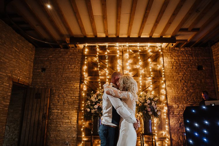 First Dance | Bride in Lace Martina Liana Wedding Dress with Long Sleeves | Groom in Blue Moss Bros. Suit | Fairylight Tythe Barn Wedding with Dreamcatchers | New Forest Studio Photography