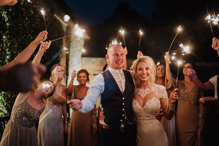 Sparkler Send Off | Bride in Lace Martina Liana Wedding Dress with Long Sleeves | Groom in Blue Moss Bros. Suit | Fairylight Tythe Barn Wedding with Dreamcatchers | New Forest Studio Photography
