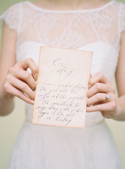 Bride Holding a Vintage Calligraphy Love Letter