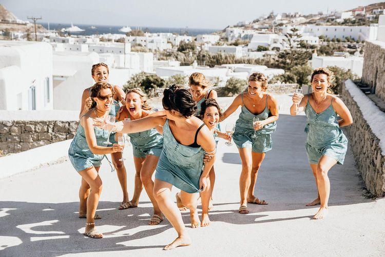 Bridal party in matching pyjamas during preparations in Mykonos