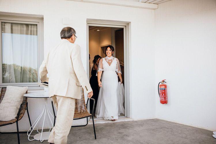 Bride appears in wedding capelet