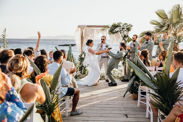 Bride and groom celebrate during ceremony