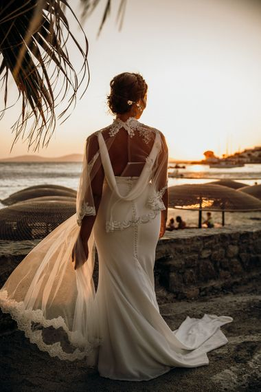 Cowl back wedding dress with wedding capelet over