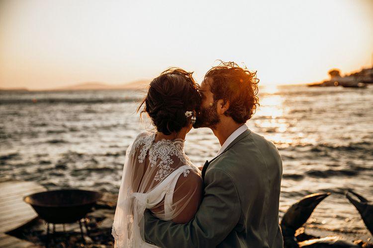 Wedding capelet for bride as she kisses groom