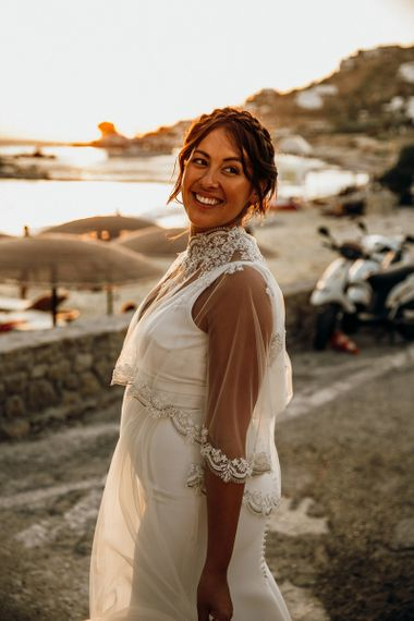 Pregnant bride wearing wedding capelet