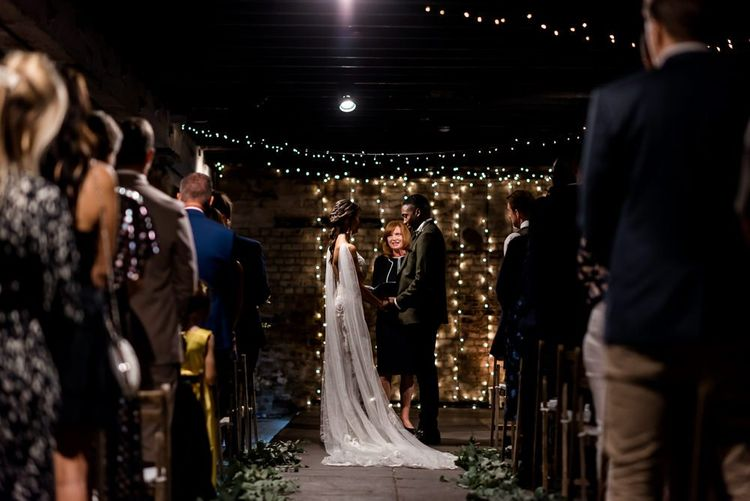 Wedding ceremony at Trinity Buoy Wharf with bride in Grace Loves Lace Rosa wedding dress