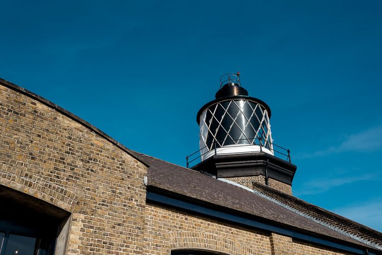 Trinity Buoy Wharf lighthouse wedding with bride in Grace Loves Lace Rosa bridal gown
