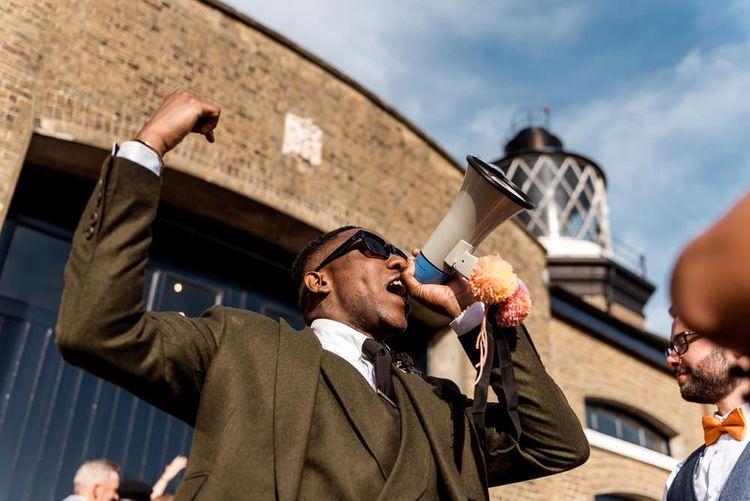 Groom speaking on a megaphone