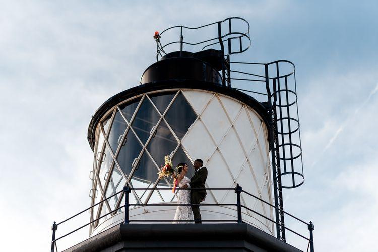 Bride and groom portrait at Trinity Buoy Wharf lighthouse