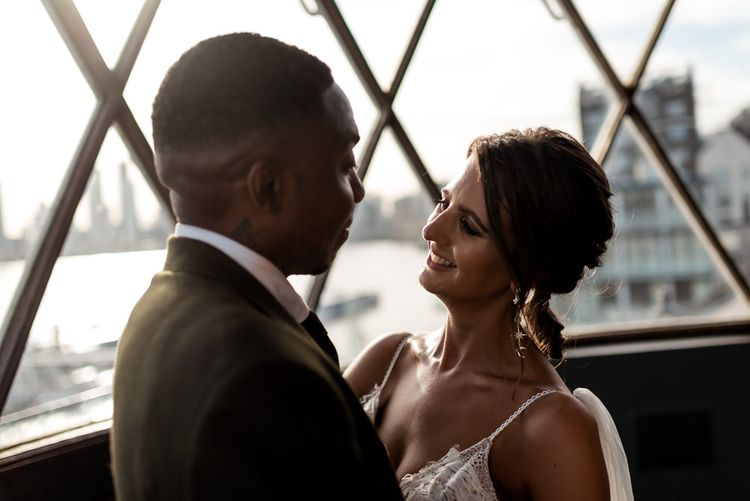 Bride in Grace Loves Lace Rosa wedding dress and groom in Hackett London suit