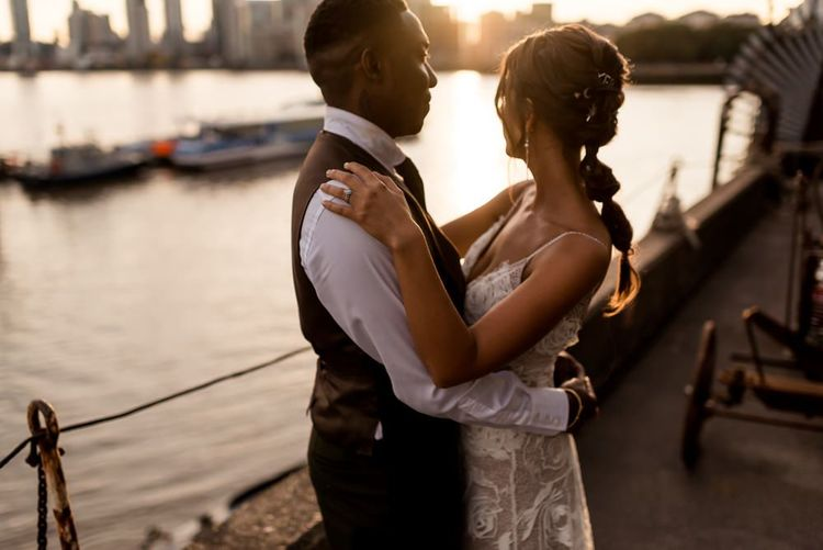 golden hour portrait of bride in Grace Loves Lace Rosa wedding dress and groom in waistcoat