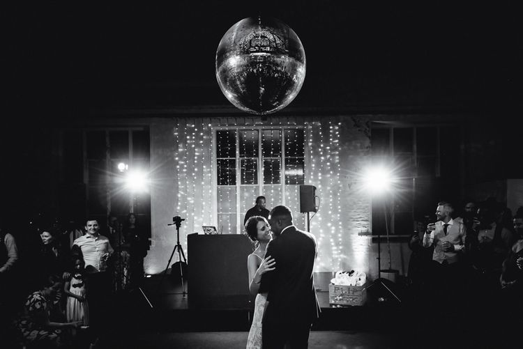 Black and white portrait of bride and groom on the dance floor