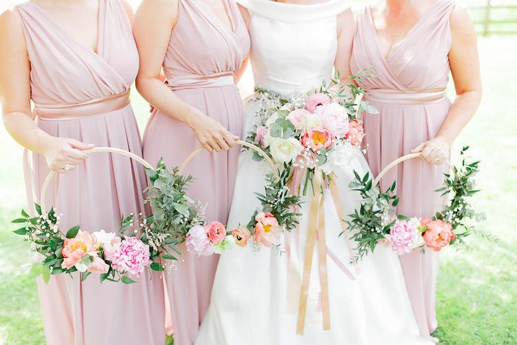 Bridesmaids With Floral Hoops Instead Of Bouquets