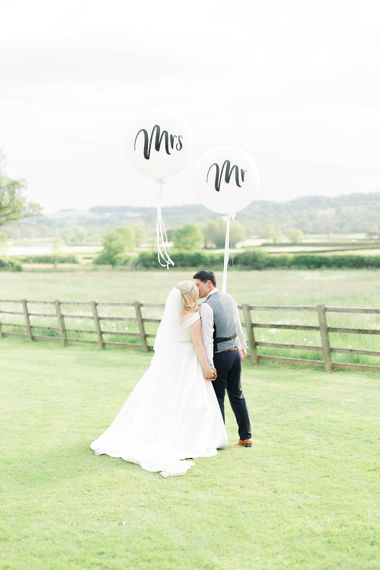 Mr & Mrs Balloons // Hyde House Cotswolds Wedding With Coral Charm Peonies And Bridesmaids With Floral Hoop Bouquets Images From White Stag Wedding Photography Film Dan Dolan