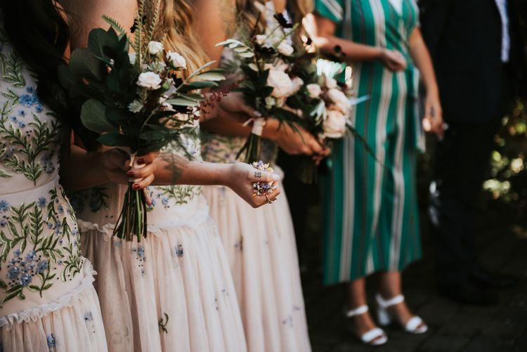 Bridesmaids in Blush Drop Waist Dresses with Embroidered Flowers by ASOS | Bouquets of Dusty Pink and Burgundy Flowers with Foliage | Peacock Chairs, Sweetheart Table and Leather Jackets for Autumn Wedding at The Copse |  Rosie Kelly Photography