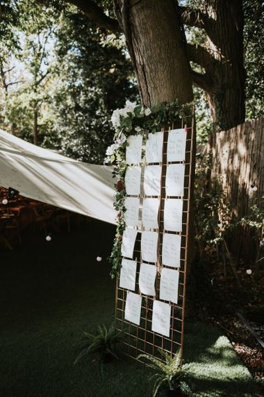Copper Metal Grid Seating Plan | Peacock Chairs, Sweetheart Table and Leather Jackets for Autumn Wedding at The Copse | Rosie Kelly Photography