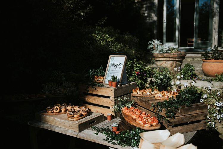 Canapes Table with Wooden Crates and Foliage | Peacock Chairs, Sweetheart Table and Leather Jackets for Autumn Wedding at The Copse | Rosie Kelly Photography