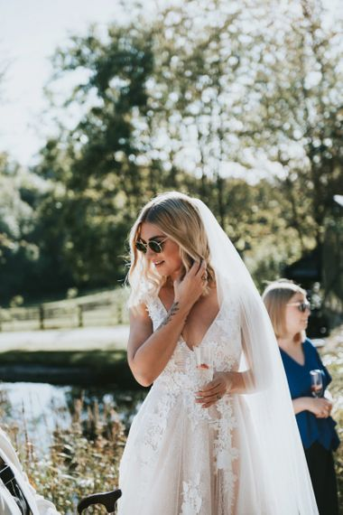 Bride in Katia Dress by Novia D'Art with V-Neck, Plunge Back and Embroidered Lace Overlay | Cathedral Length Veil | Peacock Chairs, Sweetheart Table and Leather Jackets for Autumn Wedding at The Copse |  Rosie Kelly Photography