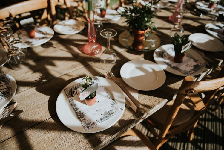 Potted Succulent Place Setting | Wedding Breakfast Menu | Pink Glass Candleholders | Potted Ferns | Peacock Chairs, Sweetheart Table and Leather Jackets for Autumn Wedding at The Copse | Rosie Kelly Photography