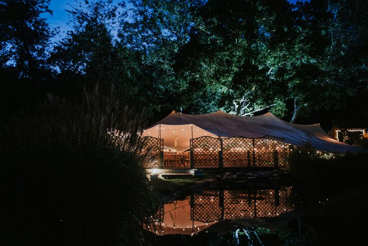 Stretch Tent Wedding Reception at The Copse | Festoon Lights | Peacock Chairs, Sweetheart Table and Leather Jackets for Autumn Wedding at The Copse | Rosie Kelly Photography