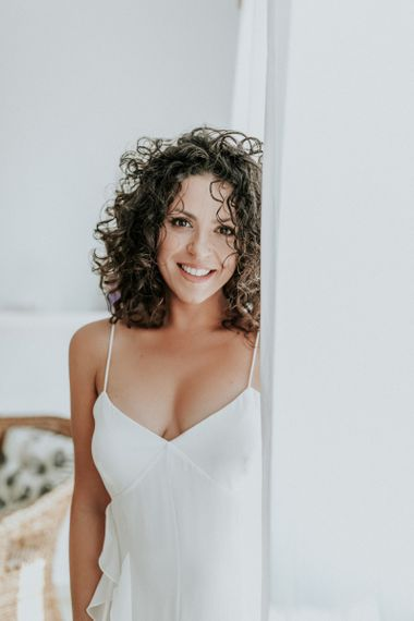 Curly haired bride in Max Mara wedding dress
