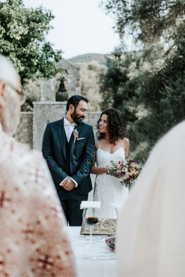 Bride in Max Mara wedding dress with groom at ceremony