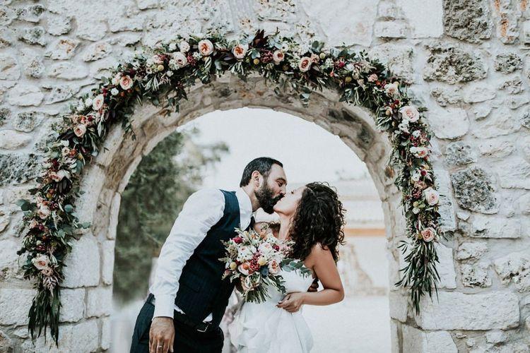 Pink flower arch at Greek wedding