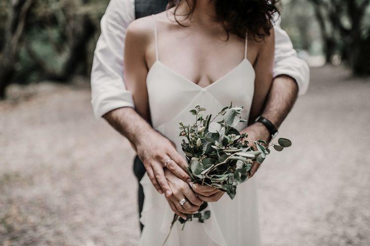Max Mara wedding dress with foliage bouquet