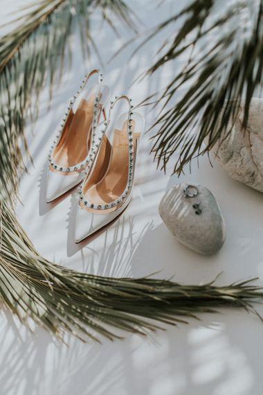 Christian Louboutin wedding shoes with Max Mara bride dress